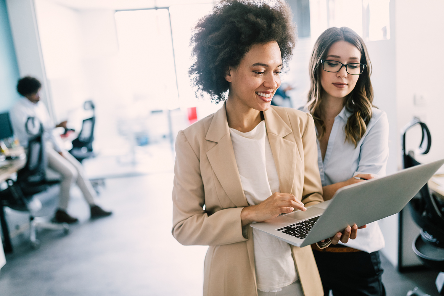 Learning People | 2 women professionals in office with laptop