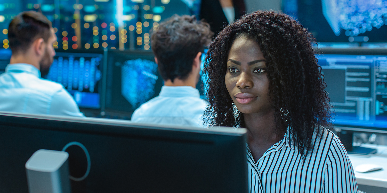 Learning People | Woman cyber security professional at desk