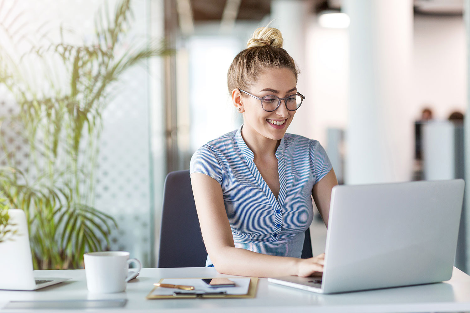 Learning People | Woman professional on laptop