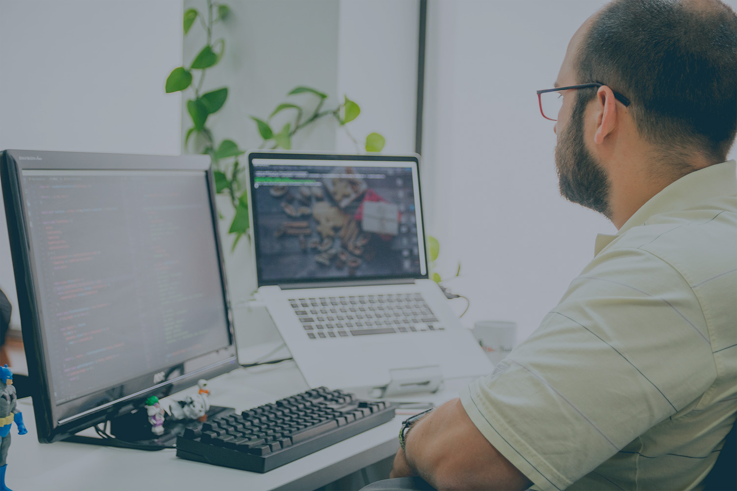 Learning People | IT professional working at desk with 2 screens