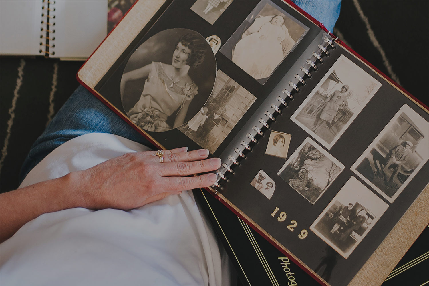 elderly lady looking at black and white photographs