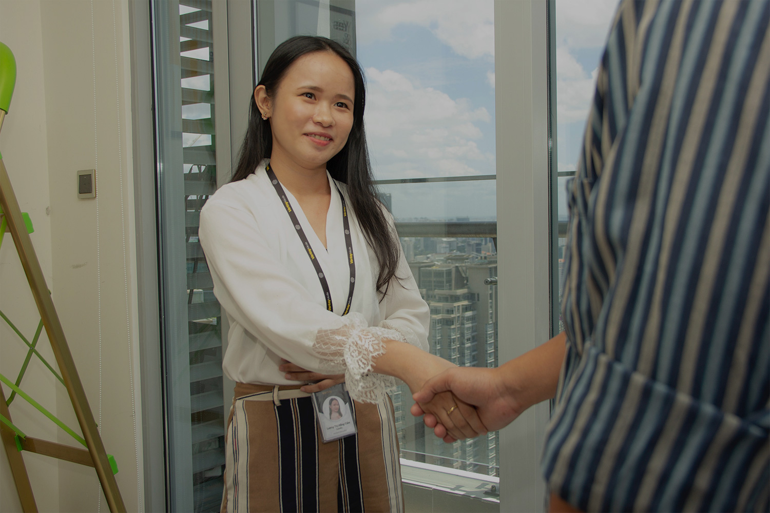 young woman shaking someone's hand planning her career