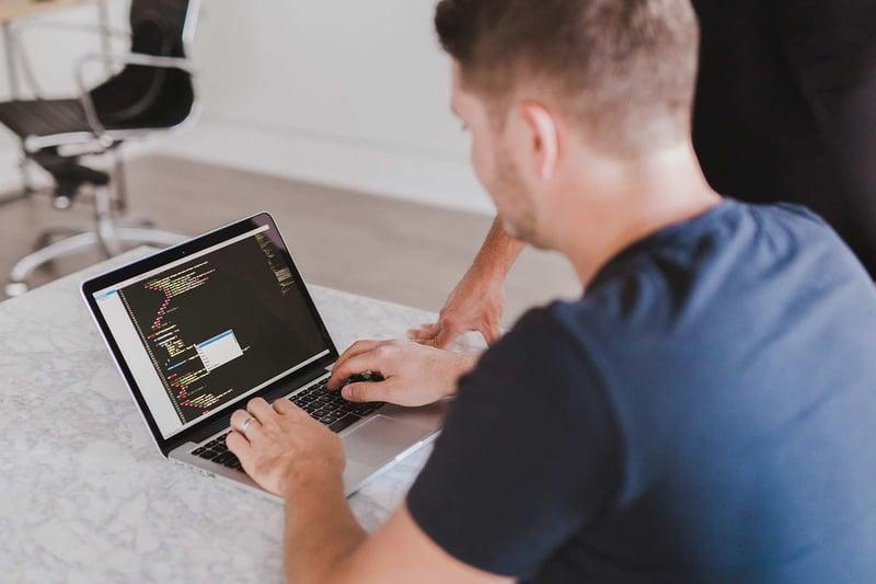Learning People | Developer coding on laptop