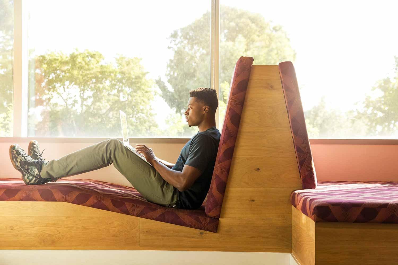 man-chilling-on-laptop