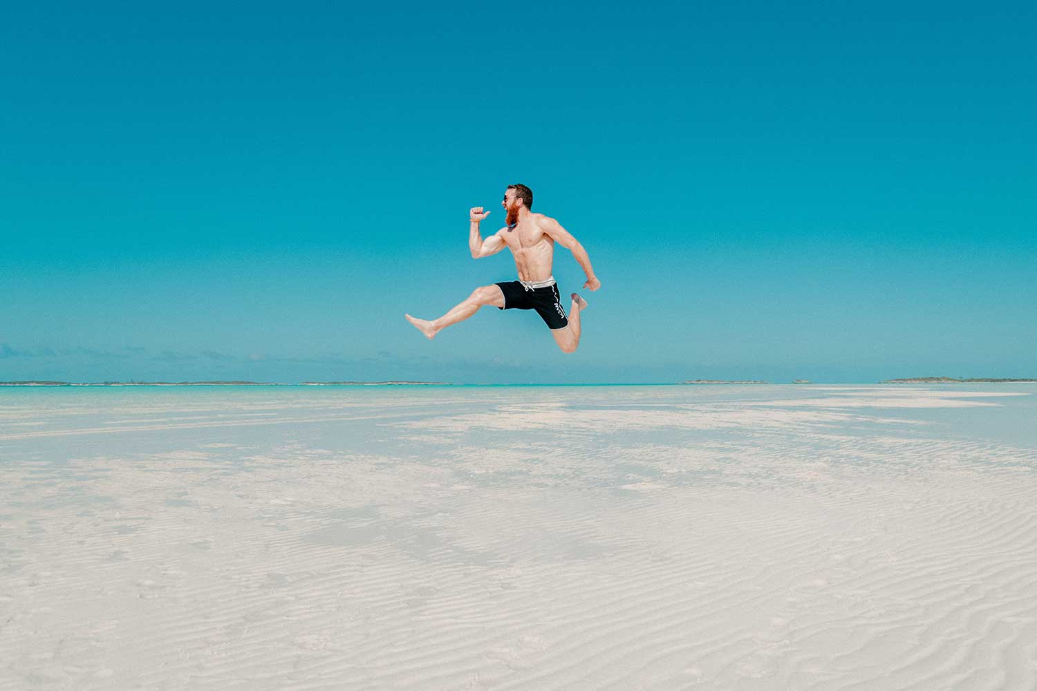 man-jumping-in-blue-sky-3.jpg