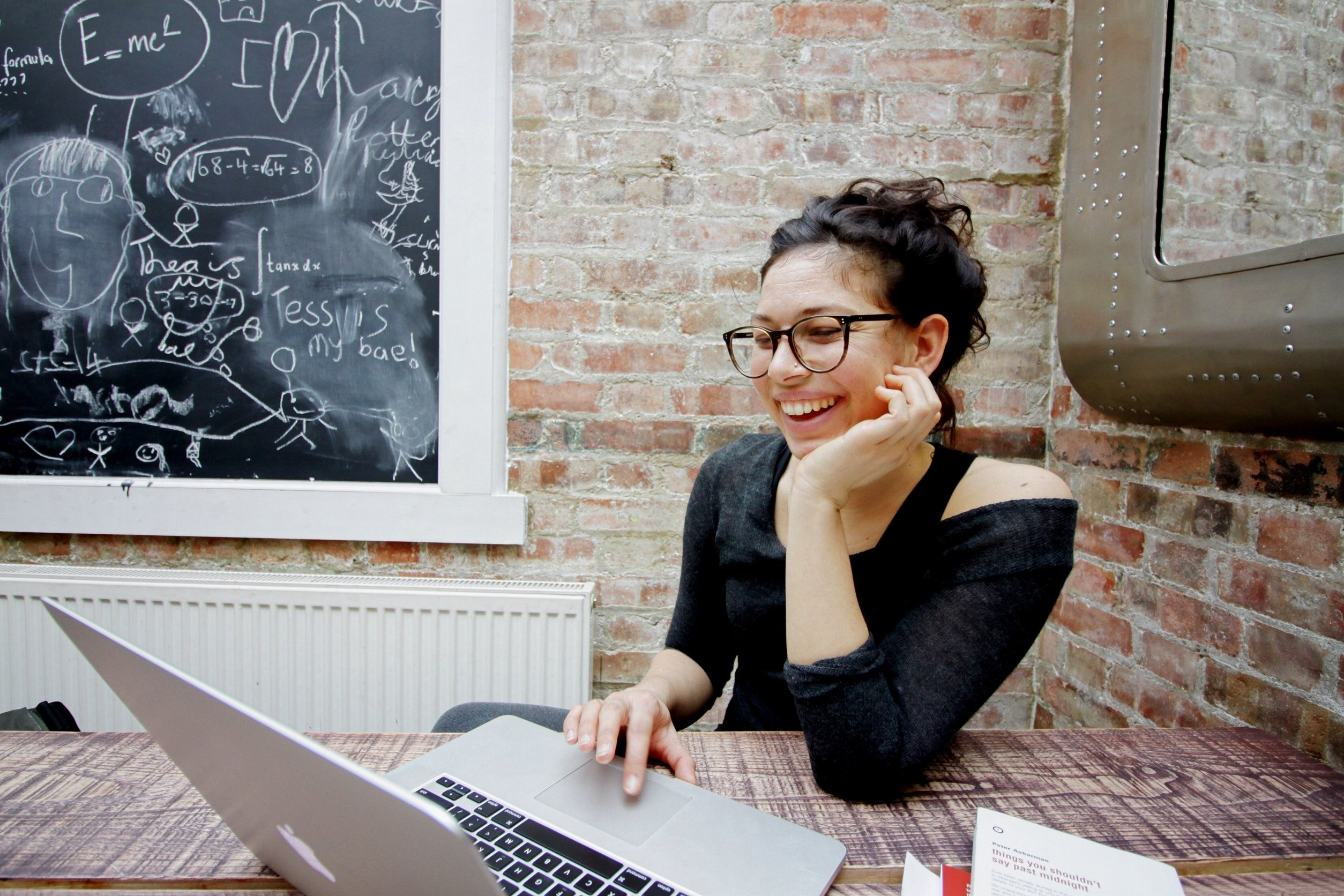 Woman smiling working on laptop