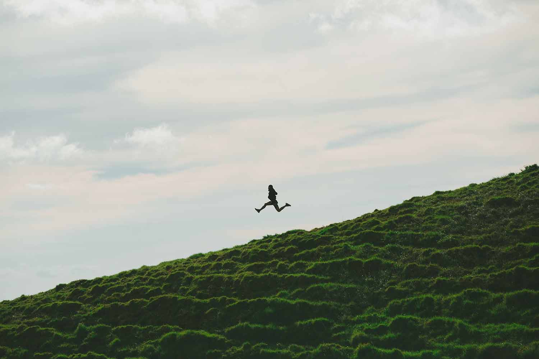 woman-running-down-a-hill