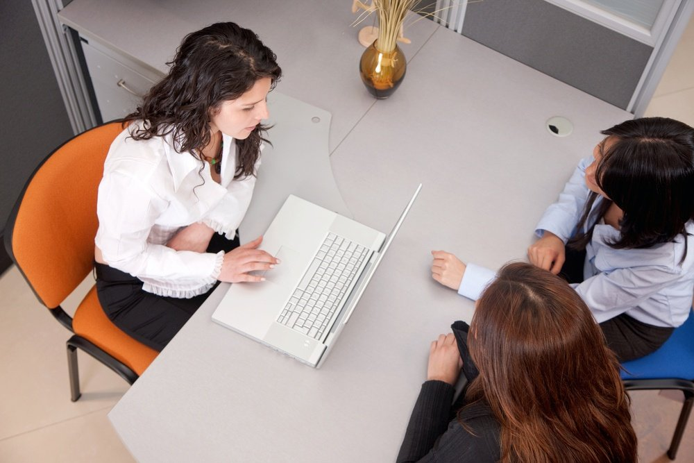 Business women with a laptop at the office