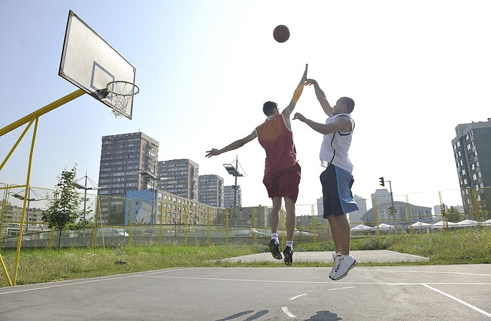 streetball basketball game with two young player at early morning on city court.jpeg