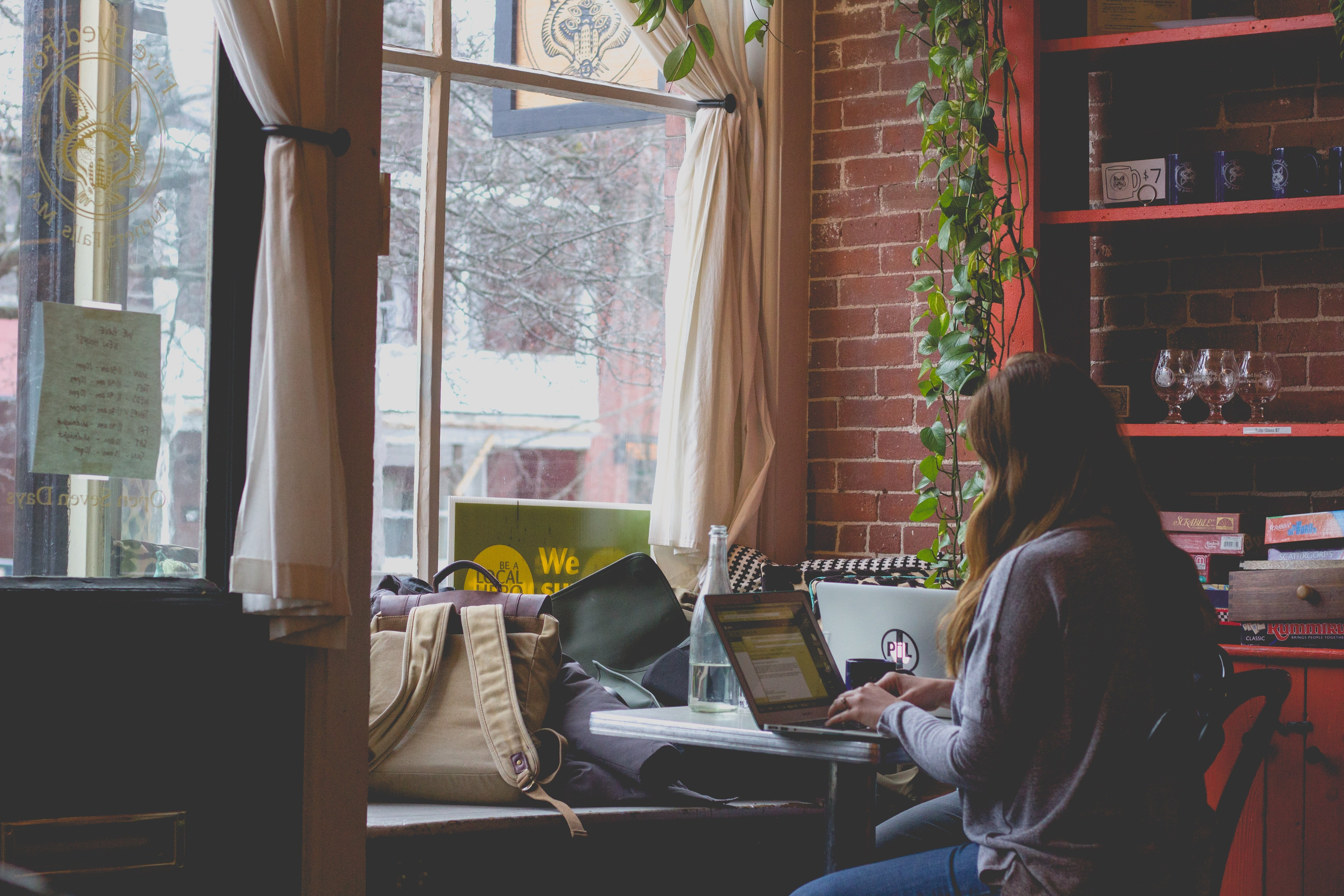 Woman on a laptop in a cafe