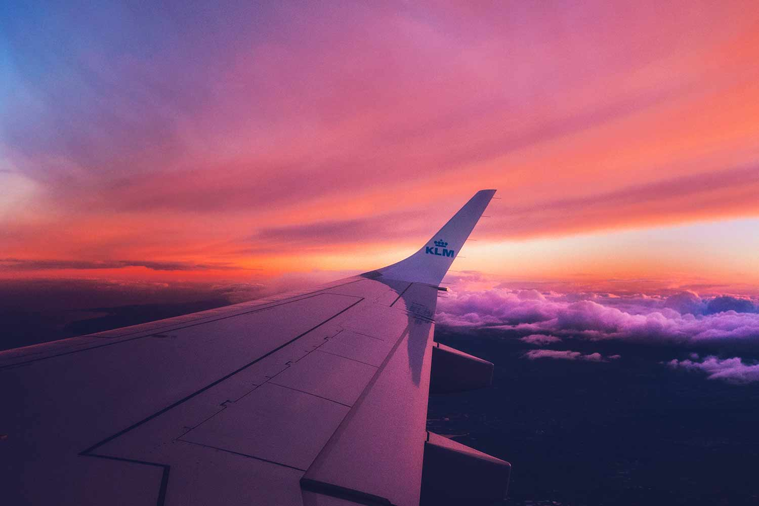 aeroplane wing with sunset behind