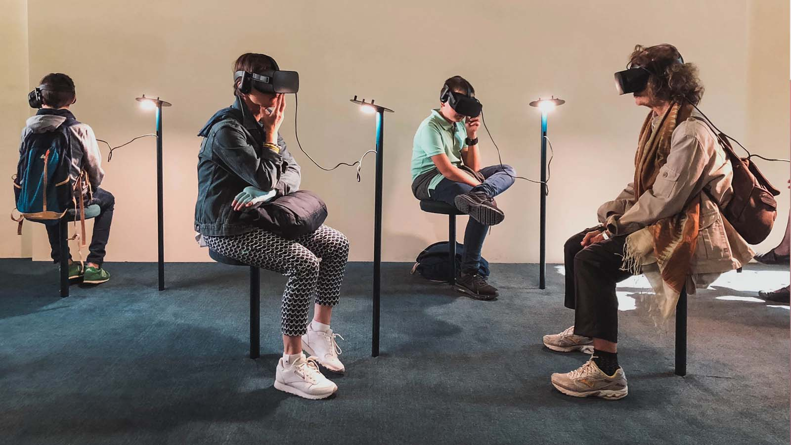 four individuals of different ages wearing VR headsets