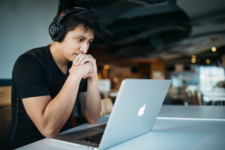 guy watching on laptop
