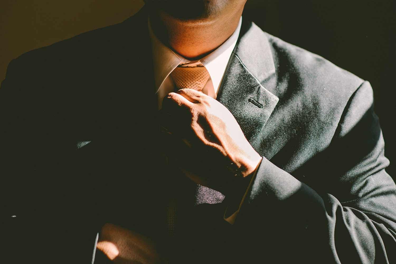 man-loosening-tie